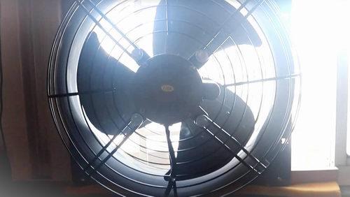 fan in window facing in or out